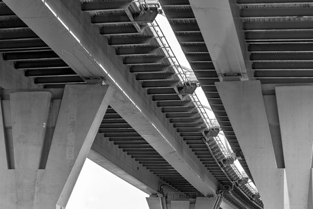 part of an engineering construction or structure of the big automobile bridge or viaduct with a reinforced concrete march and support closeup Фото со стока