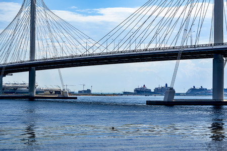 the big modern cable-stayed bridge over the river or over the gulf in St. Petersburg against the background of the sky and a cloudy landscape