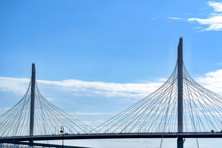 the big and modern cable-stayed bridge in St. Petersburg against the background of the cloudy sky Фото со стока