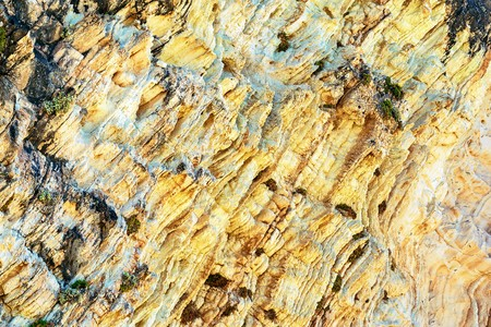 abstract corrugated texture of the stony rock closeup for an abstract natural background