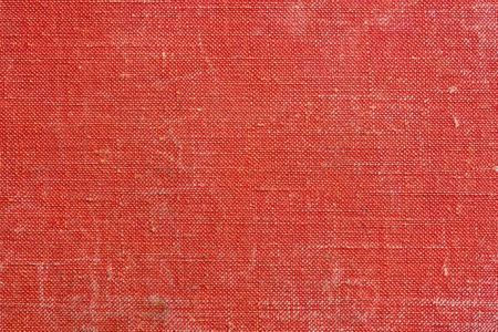 abstract texture of old corrugated paper or other old material closeup for a background or for wallpaper of red fiesta color