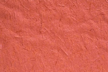 texture a closeup of old rough paper or other old material for a background or for wallpaper of living coral color