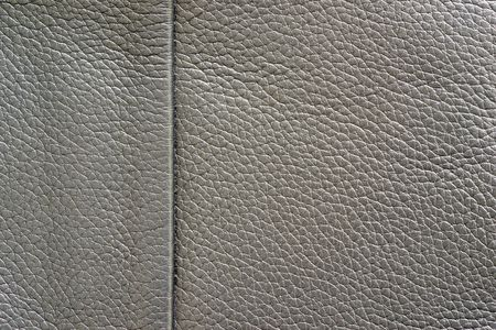texture of skin or other leather material closeup for a background or for wallpaper of gray color