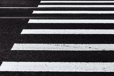 road marking of the crosswalk on asphalt closeup for a background