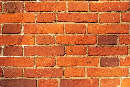 corrugated brick texture of orange color for a background or for wallpaper 写真素材
