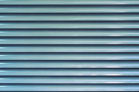 the abstract corrugated textured background a closeup of blue color