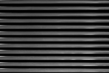 the abstract corrugated textured background a closeup of black color 版權商用圖片