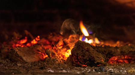 abstract indistinct texture of fire and burning in a fireplace or in the home furnace closeup