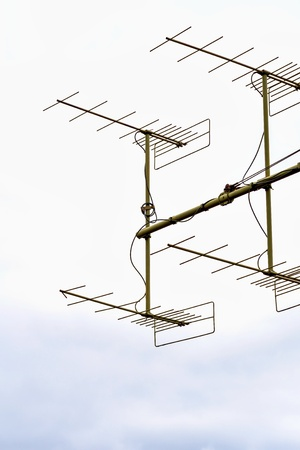 big metal military antennas for a radio communication closeup separately against the background of the empty and clear white sky