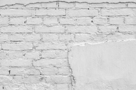 surface of an old brick wall with the destroyed plaster of white color for the vintage and abstract textured background Stok Fotoğraf