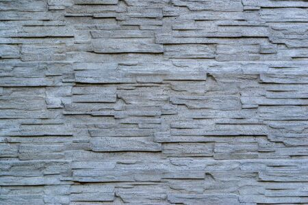 abstract corrugated and rough texture concrete walls for a background or for wallpaper
