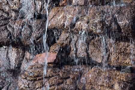 stone wall with falls close up for the natural textured background Stock Photo - 124870710