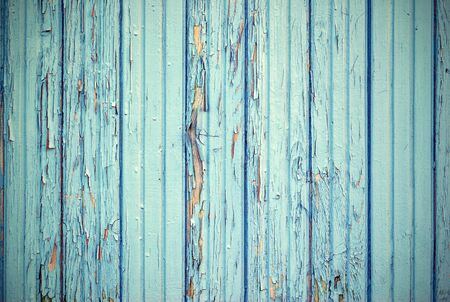 the old painted texture of the panel from wooden boards for a background or for wallpaper of blue color in retro style