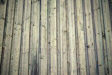 old monochrome texture of wooden boards closeup for a natural background or for wallpaper in vintage style
