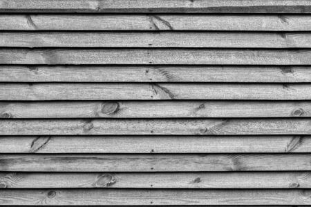 the textured background from wooden boards closeup for a natural background or for wallpaper of monochrome tone