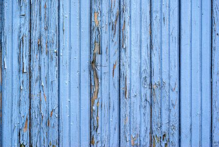 the old painted texture of the panel from wooden boards for a background or for wallpaper of blue color