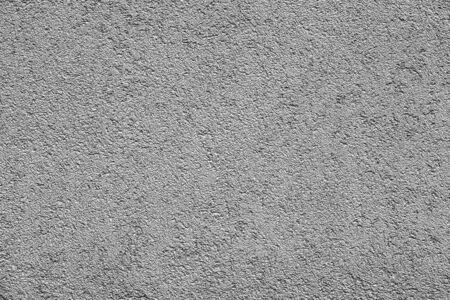 the empty and clean plastered wall of gray tone for an empty background or for wallpaper with rough texture