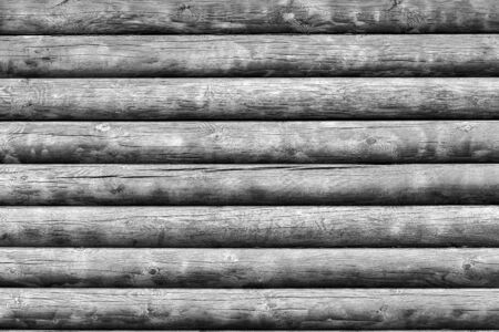 The textured surface of the wooden log wall for a background or wallpaper of monochrome tone. 스톡 콘텐츠