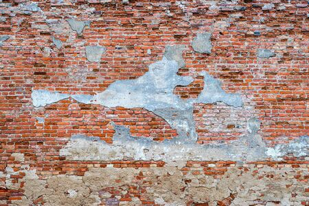 Structure of the old destroyed wall for a vintage background closeup.