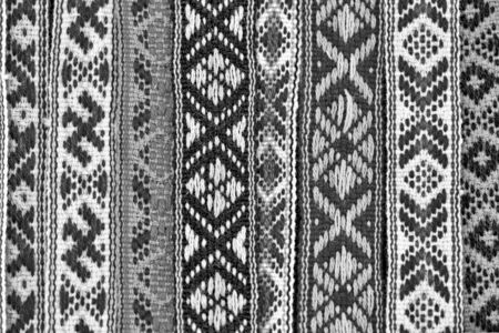 The weaved fabric with the textured ethnic belarusian pattern closeup for an abstract background or for wallpaper of monochrome tone. 스톡 콘텐츠