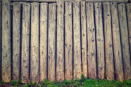 Old timbered wall for the textured background or for vintage wall-paper on a photo in a retro style.