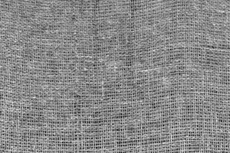 Texture of rough mesh fabric or textile material for a background and for wall-paper of monochrome tone. 스톡 콘텐츠