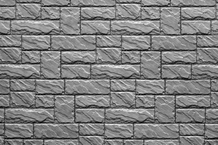 Corrugated checkered texture of a concrete wall or facade for a background or for wallpaper of monochrome tone.