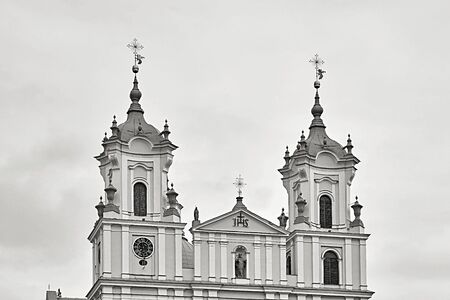 architecture of the top part of the Catholic temple closeup against the background of the sky monochrome tone