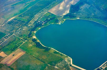 landscape panoramic view of the land with the lake from the altitude of the aircraft 写真素材