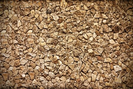 rough textured background surface of sepia tone covered with stones abstract shape 写真素材