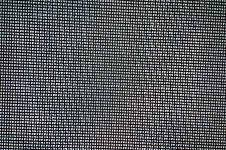 textured surface of coarse checkered fabric or textile grid material for background or for wallpaper