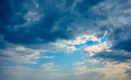 sky with white clouds and storm clouds for abstract natural background 写真素材