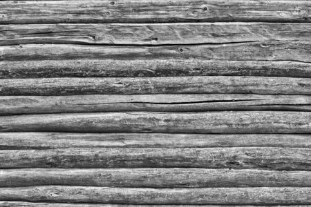 Texture closeup of old wooden log wall for abstract background of monochrome tone