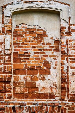 ancient frame niche in an old brick wall for a vintage textured background