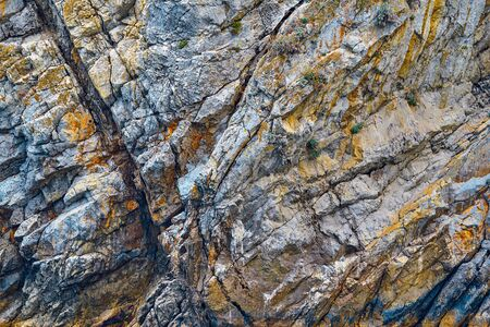 bumpy texture of a part of a rock with a natural stone closeup for an abstract natural background Stock Photo