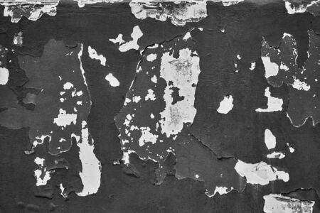 large abstract stains damaged and shattered plaster wall surface closeup of monochrome tone for background