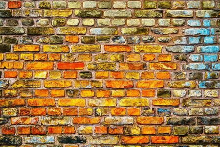 motley texture of an old brick wall for an abstract background or for wallpaper Banco de Imagens