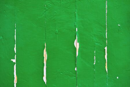 painted surface of old board green for background or wallpaper