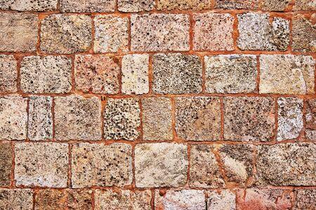 terracotta brickwork wall texture made of seashell blocks for background or wallpaper Banco de Imagens