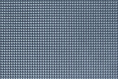 granular corrugated texture with small convex pyramids or teeth of regular square shape arranged symmetrically and in even order in horizontal and vertical rows
