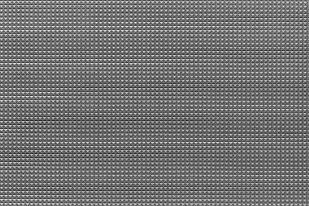 granular corrugated texture with small convex pyramids or teeth of regular square shape for background or for wallpaper