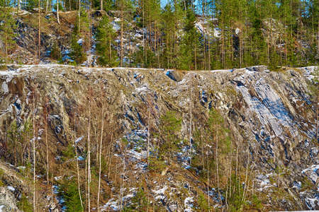 mountain landscape with trees on rocks for a natural background or for wallpaper Stock fotó