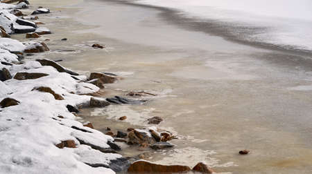 abstract spring and winter landscape of rocky shore close-up Stock fotó