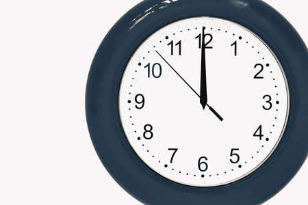 large of blue color analog clock show 12 hours at midnight or noon close-up