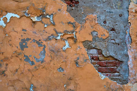 abstract part of the old brick wall with ruined plaster for vintage background and wallpaper