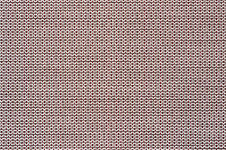 macrotexture of fabric or coarse textile material close-up with symmetric and identical mesh plexus for abstract empty background or for wallpaper