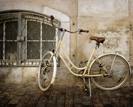 old style rusty bicycle and wall photo