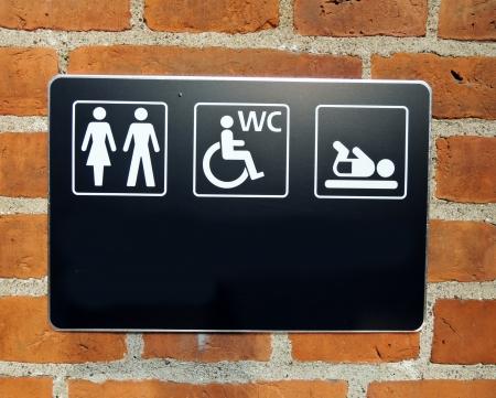 toilette: toilette sign on wall
