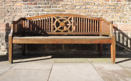 wooden bench on a wall of brick Stock Photo - 18502695