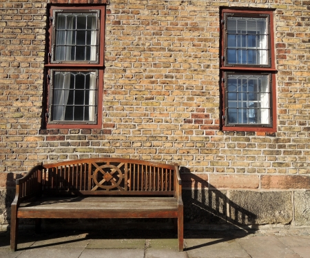 wooden bench on a wall of brick Stock Photo - 18502719